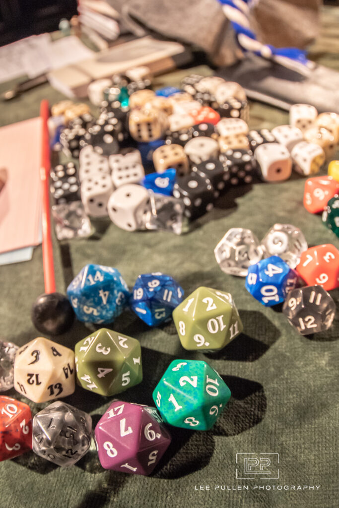 A picture of numerous colourful, multi-sided dice